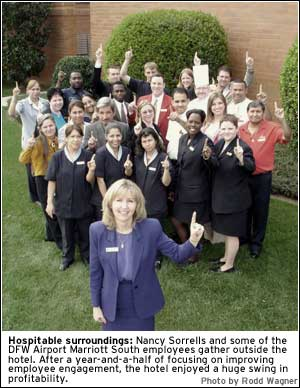PHOTO: Hospitable surroundings: Nancy Sorrells and some of the DFW Airport Marriott South employees gather outside the hotel. After a year-and-a-half of focusing on improving employee engagement, the hotel enjoyed a huge swing in profitability.