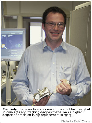 PHOTO: Precisely: Klaus Welte shows one of the combined surgical instruments and tracking devices that allows a higher degree of precision in hip replacement surgery.